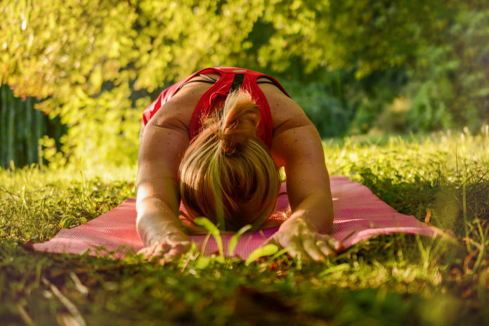 women practicing yoga outside